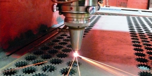 Cutting the metal steel with a laser machine